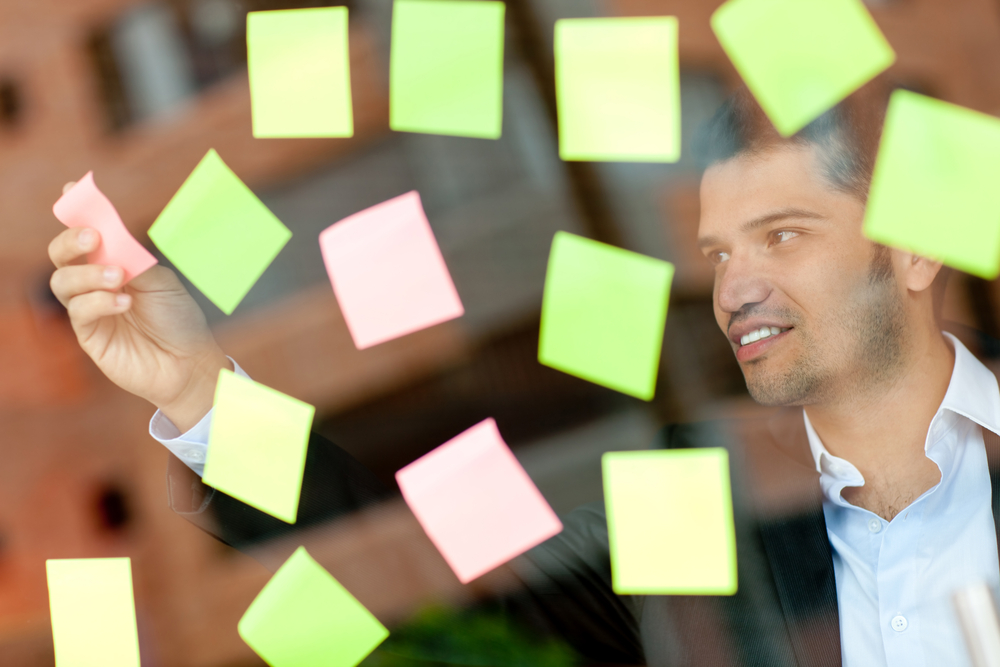 Multitask business man with lots of post-its